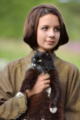Young beautiful girl with a cat. Herbal, advertisement.