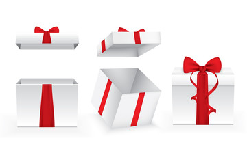 Set of square open gift boxes with satin ribbons and bows.