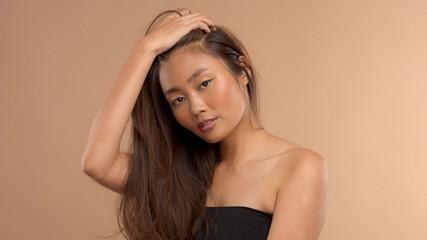 thai asian model touching her straigh hair