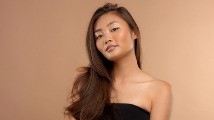 thai asian mode with ideal shiny skin and straight hair