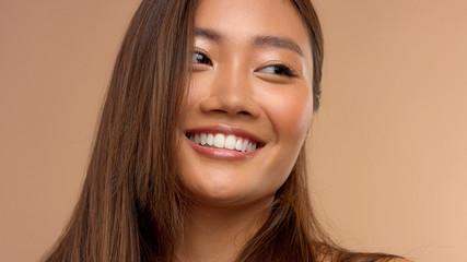 wide smiling thai asian japanese model watching aside