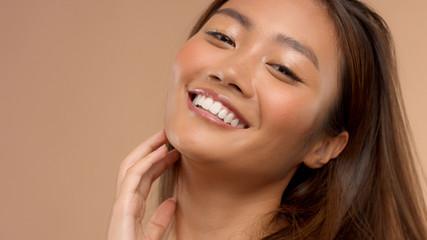 closeup portrait o asian thai japanese model happy laughing