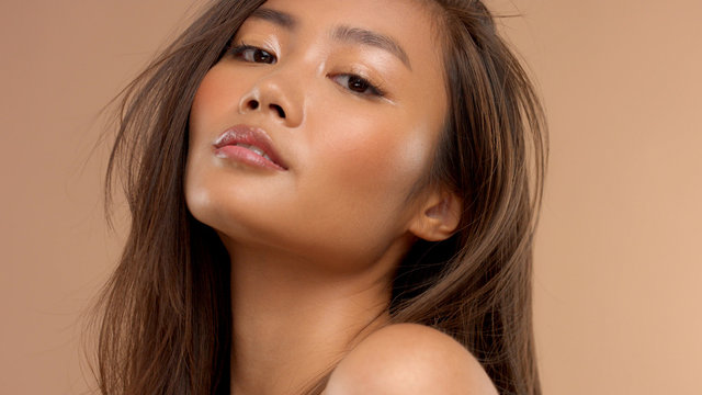 sensual portrait of asian model with ideal skin and straight hair