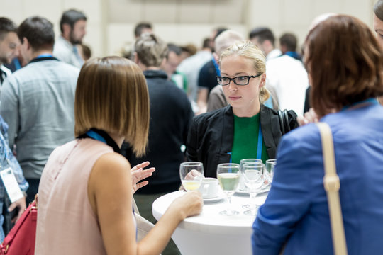 Expert people interacting during coffee break at business, medical or scientific conference.