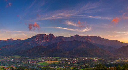 Wall Mural - Tatra Mountains and resort Zakopane in the rays of the setting sun