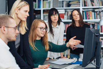 Young woman explaining to her business team