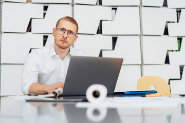 Young businessman sitting pondering a problem