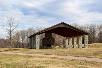 A view of the picnic shelter in the park on a sunny day.