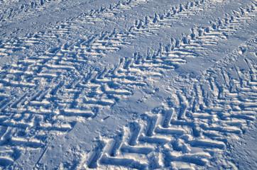 Car tire tread on snow.