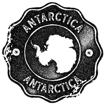 Antarctica map vintage stamp. Retro style handmade label, badge or element for travel souvenirs. Black rubber stamp with country map silhouette. Vector illustration.
