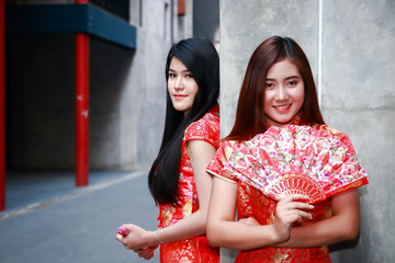 Beautiful woman wearing Chinese red dress Holding a smile for the Chinese New Year festival