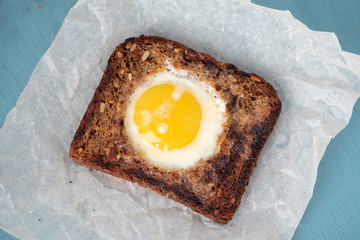 Fried rye toast with egg, top view.