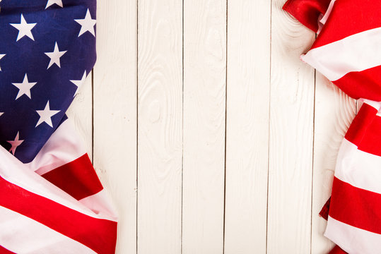 american flag on wooden background with copy space