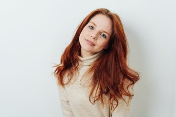 Young redhead woman looking calmly at the camera