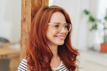 Natural smiling young redhead woman