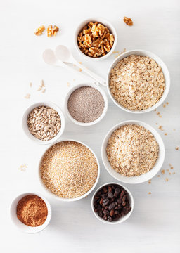 variaty of raw cereals and nuts for breakfast. Oatmeal flakes and steel cut, barley, walnut, chia, raisins. Healthy ingredients