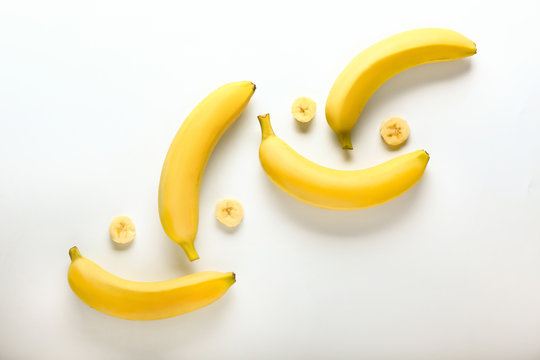 Creative composition with tasty fresh bananas on white background