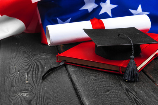 graduation hat on US flag, education concept