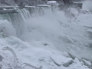 An aerial photo taken over the American side shows water flowing around ice due to subzero temperatures in Niagara Falls