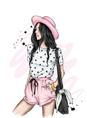 Beautiful girl in a stylish hat, t-shirt and shorts. Summer clothes. Fashion & Style. Vector illustration for greeting card or poster.
