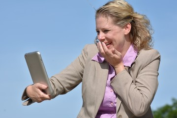 Laughing Adult Blonde Business Woman With Tablet