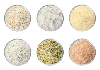 Stores photo Graine, aromate Set of organic flour in glass bowls on white background, top view
