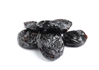 Heap of tasty prunes on white background. Dried fruit as healthy snack