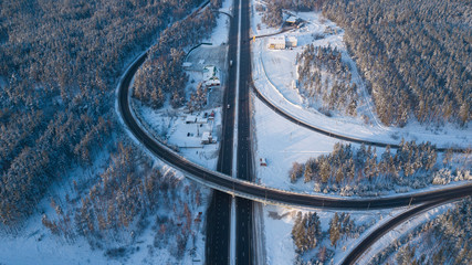 Winter aerial photo of transport junction, traffic cross road junction day.