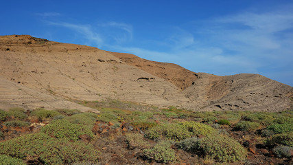 View from the basis of Montana Pelada, an arid volcanic cone formed of fossilized sand dunes, situated at one end of El Medano surf resort in south of Tenerife, Canary Islands, Spain