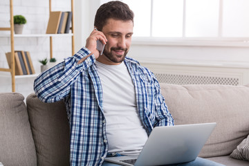 Salesman working and talking on phone at home