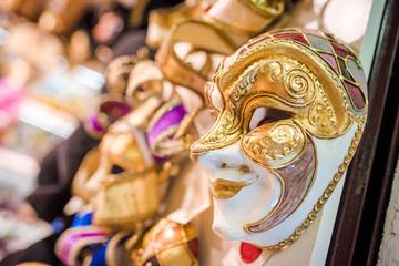 Venetian masks for a masquerade. Touristic souvenir shop.