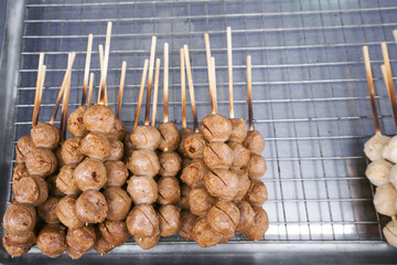 Street food meat ball sticks on grill at Thailand