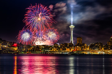 Lake Union 4th of July Fireworks and the Seattle skyline, as seen from across Elliott Bay at Seacrest Park in West Seattle