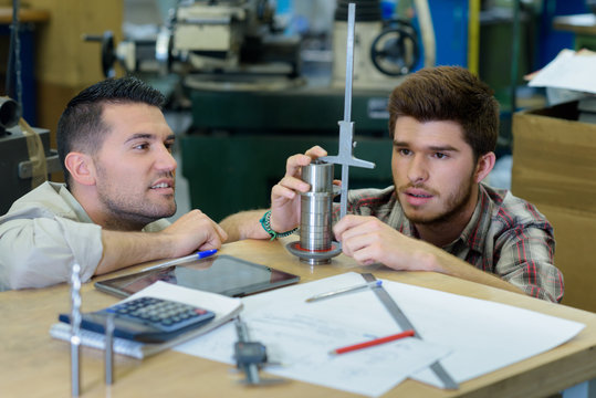 future mechanic measuring a mechanical tube part
