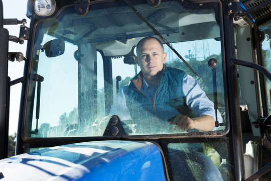 Man sitting in tractor cab