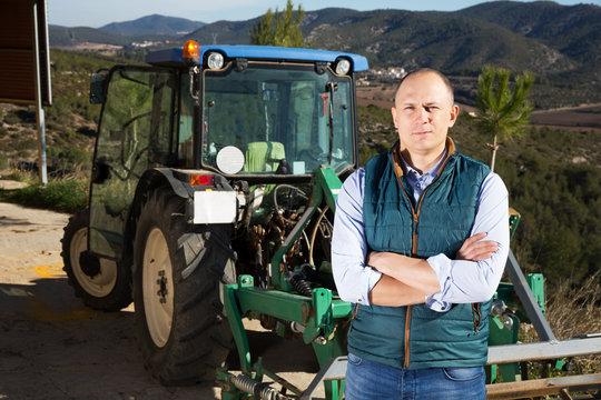 Man near tractor in vineyard