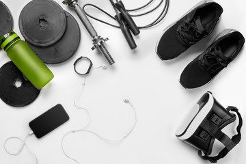 Sport background. Female sport shoes and equipment top view, copy space.