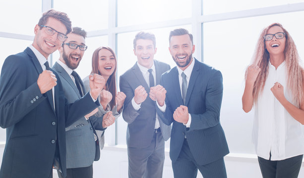 happy business team standing in office.