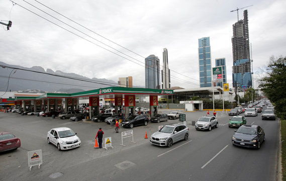 Cars line-up to buy fuel at a gas station in San Pedro Garza Garcia