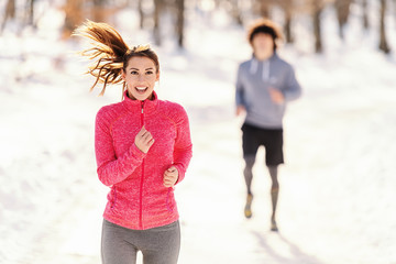 Fitness couple winter morning exercises. Winter fitness concept.