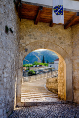The arched entrance to the Stari Most bridge in Mostar, completely empty in the early morning light!