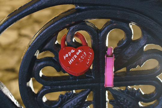 """Door lock on the bridge, closed on the wedding day. The inscription (it's not brand it is words what people tell in the wedding day) """"Yura + Natasha,2018"""""""""""