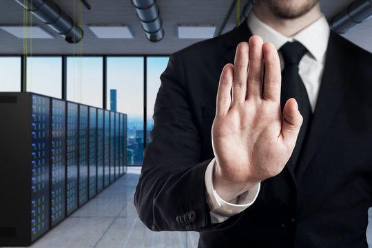 businessman in modern server room stop gesture with his hands - 3D Illustration