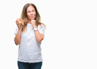 Middle age hispanic woman eating pizza slice over isolated background serious face thinking about question, very confused idea