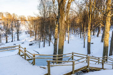 Snowy Photo of the Park on a Sunny Winter day - Wooden Footpath in the Middle of it, Concept of the Harmony and Travel