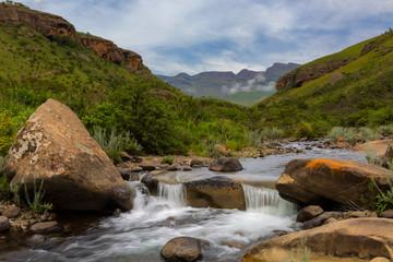 Little waterfall in mountain stream