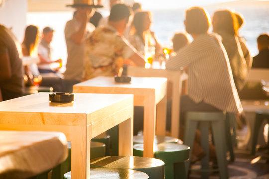 sunset bar by the beach - focus on table