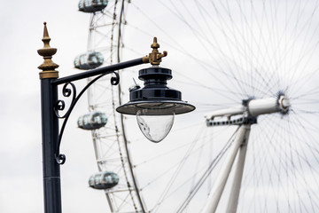 London Eye with office buildings