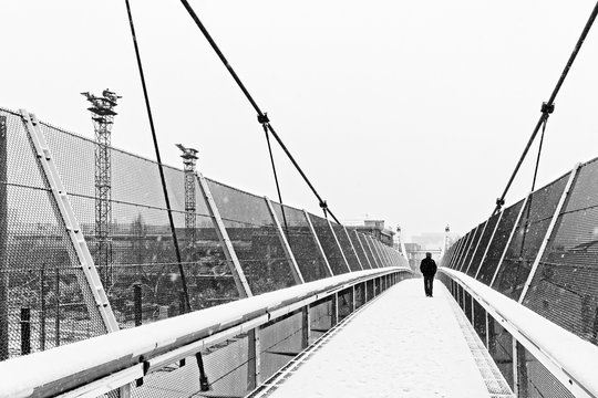 Steel footbridge   under snow in Ivry sur Seine  suburb of Paris
