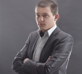 stylish young man in a gray suit.isolated on grey